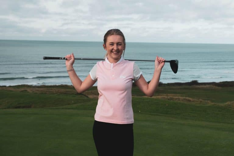 An image of a female golfer wearing a Low Profile shirt.