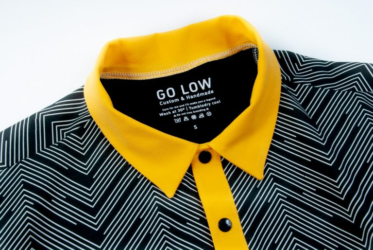 A closeup image of a Go Low shirt Traditional collar with yellow Collar and Placket and black Snaps
