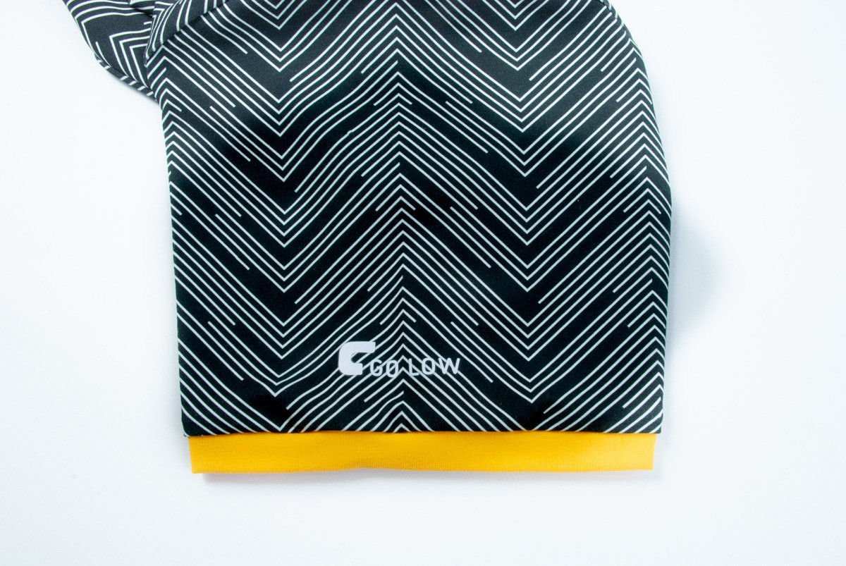 A closeup image of a Go Low shirt Sleeve with yellow Sleeve Bands