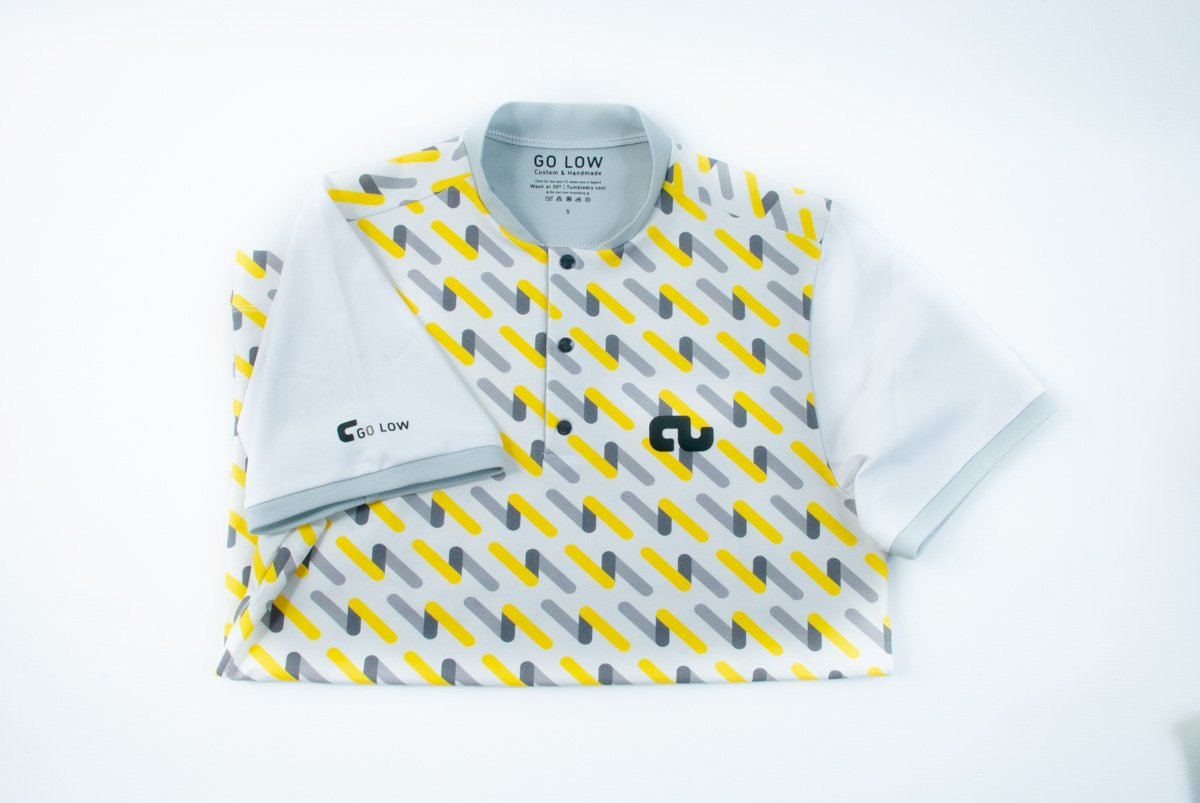 An image of a Go Low shirt folded with a Pipeline body and White sleeves.