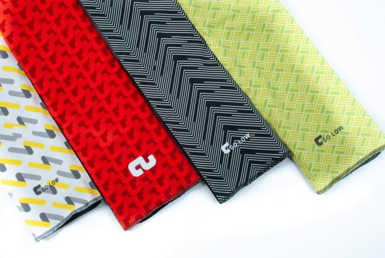 An image of a selection of Go Low custom golf towels