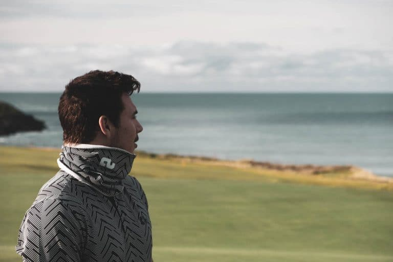 An image of a male golfer wearing a Low Profile Collar shirt.