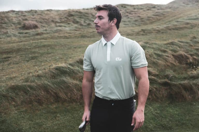 An image of a male golfer wearing a Traditional Collar shirt.