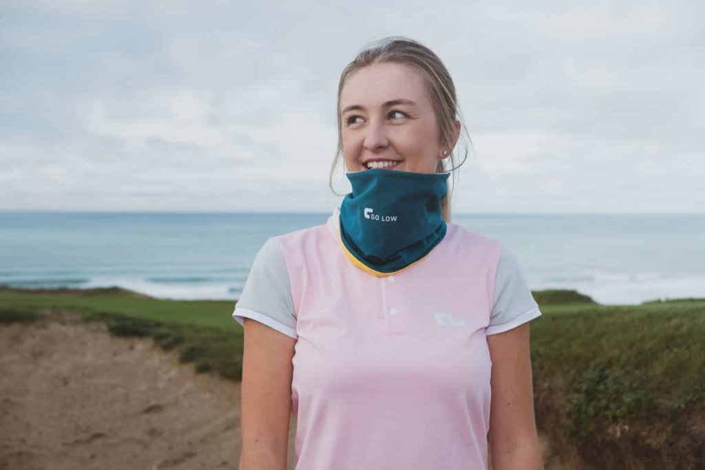 Image of gemma wearing a go low custom snood and shirt on a golf course